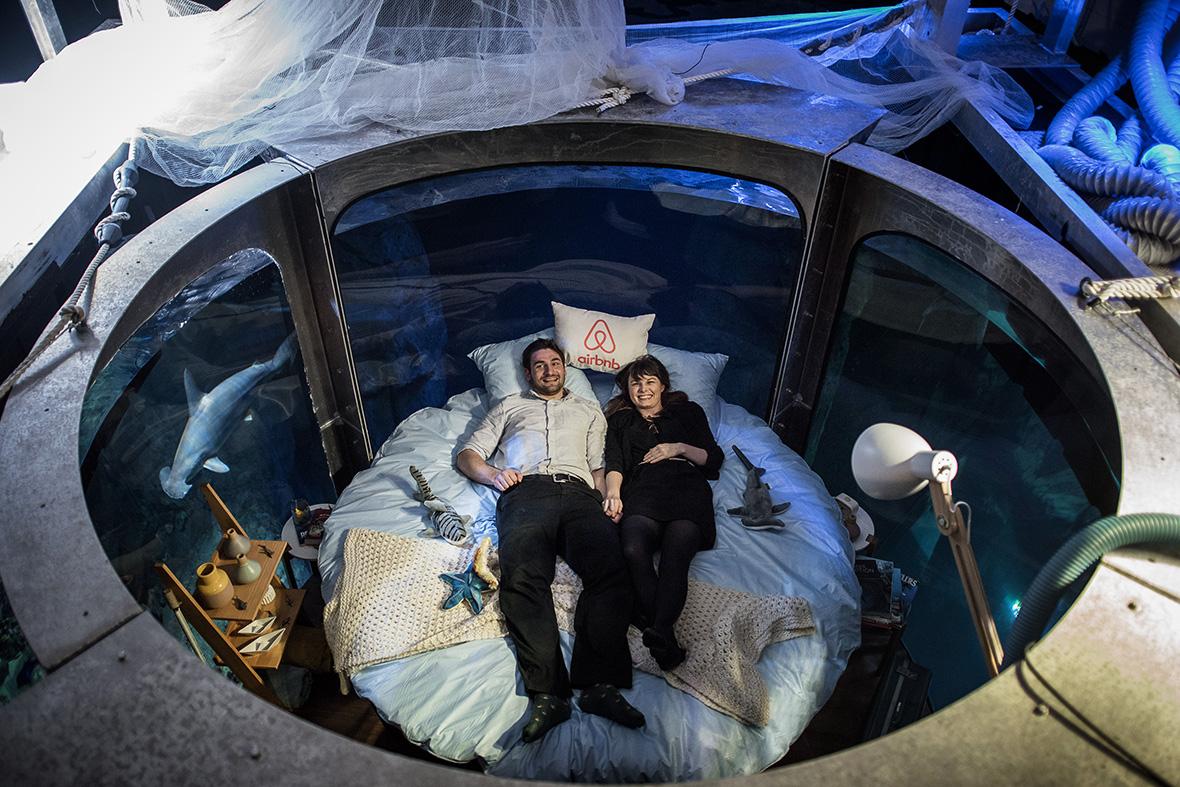 Good Aquarium Bed Part - 13: Two Winners Of The Airbnb Competition Lie In Bed At The Aquarium De Paris  Philippe Lopez /AFP