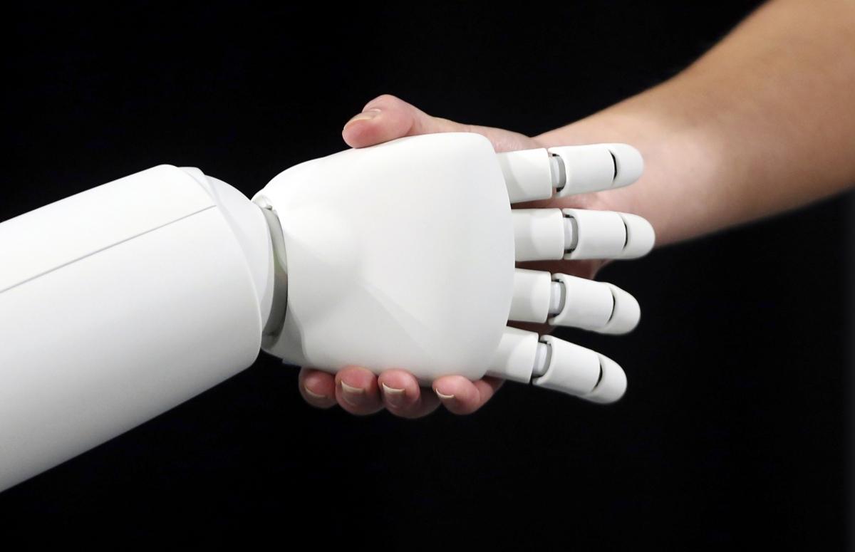 Chatbots human and robot handshake