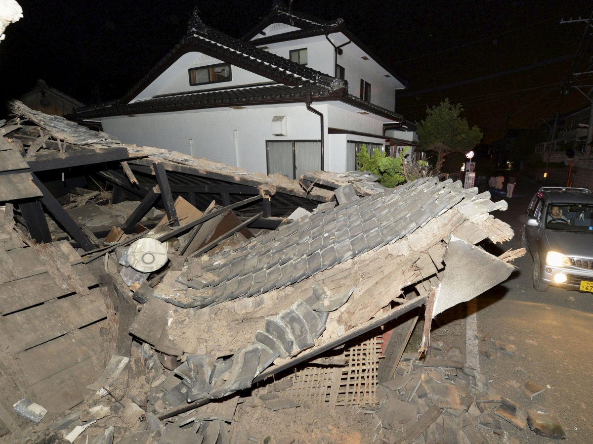 Japan earthquake: At least 9 people dead and many trapped beneath ...