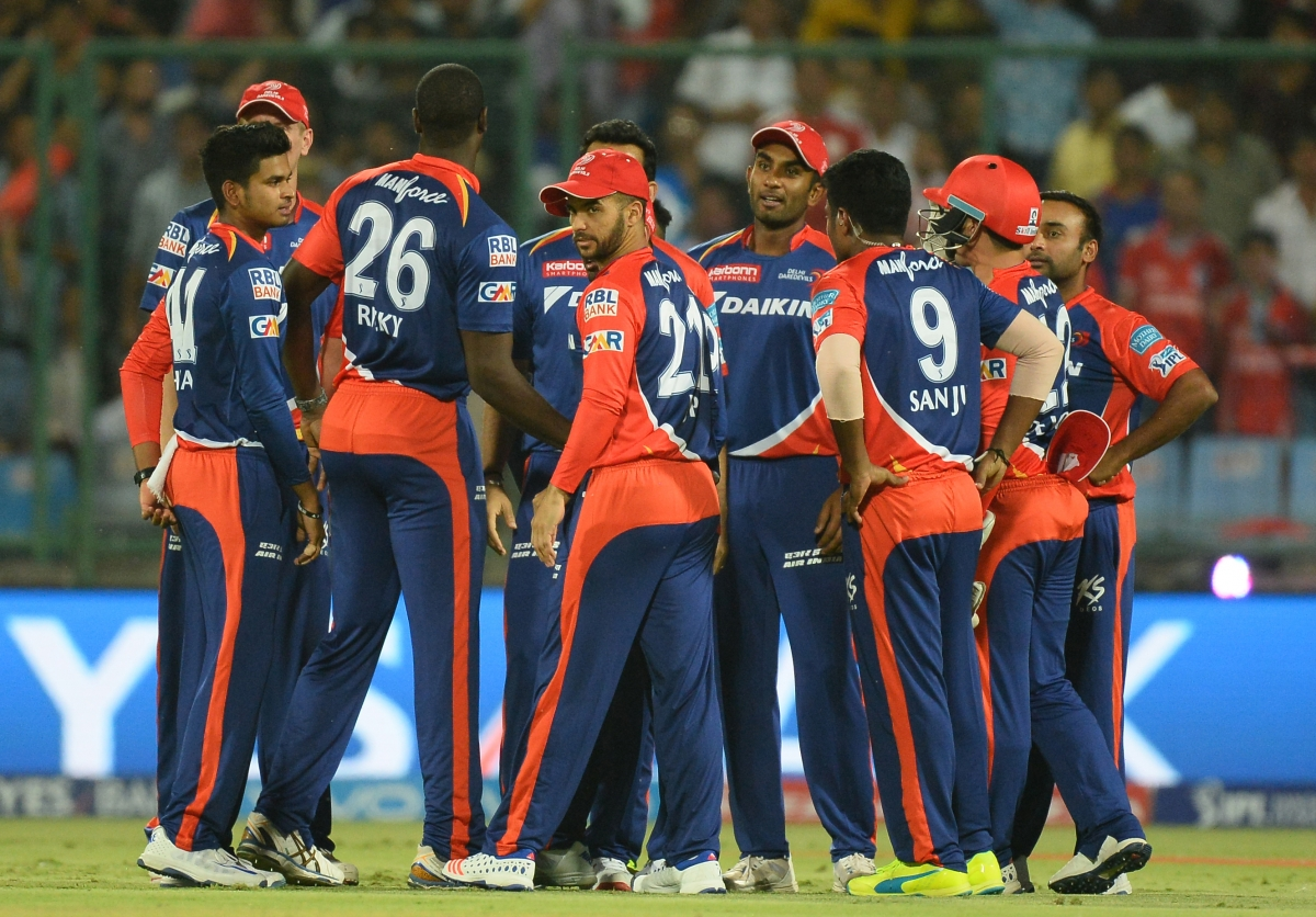 Delhi players celebrate a wicket