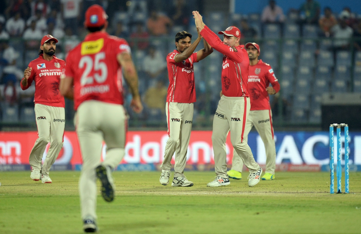 Sharma celebrates taking a wicket
