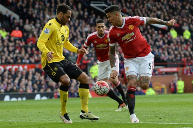 Marcus Rojo challenges for the ball