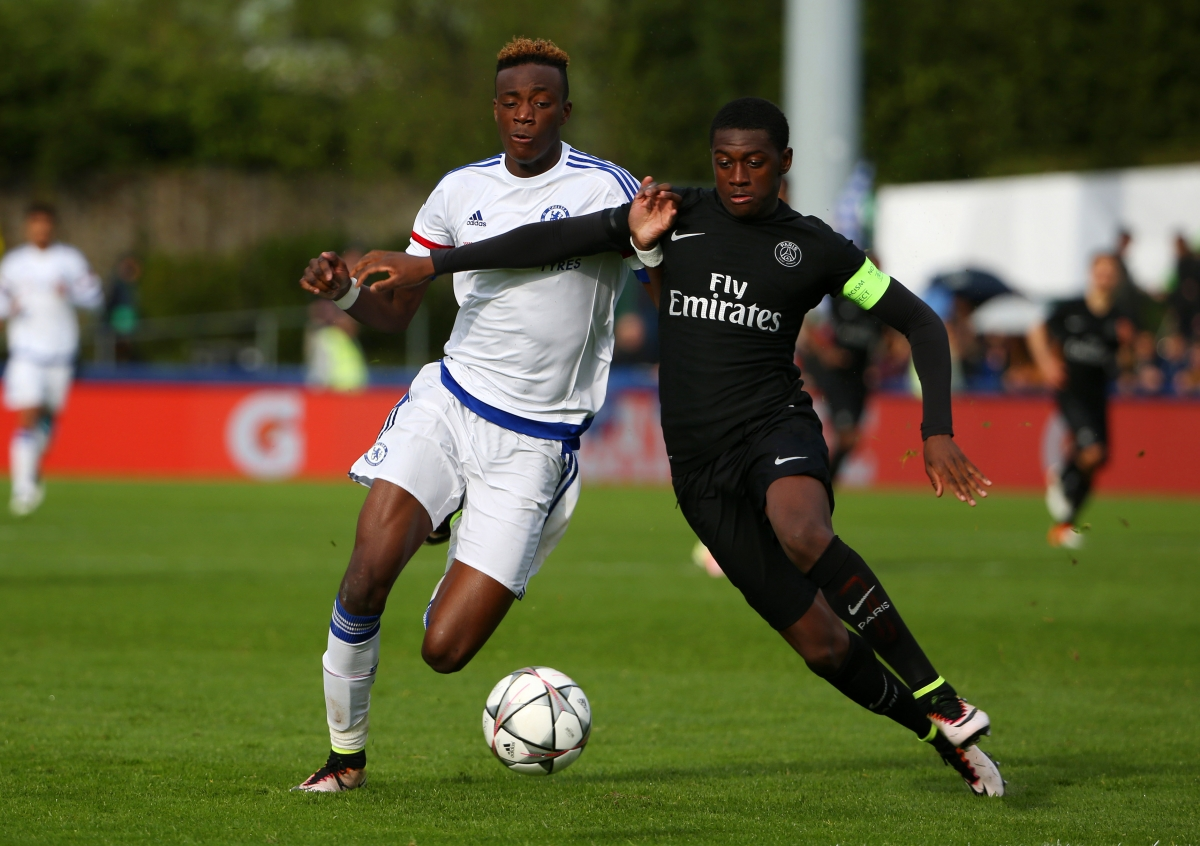 Tammy Abraham (left) fights for the ball