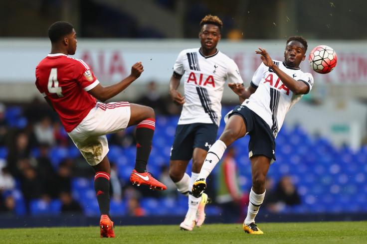 Ro-Shaun Williams (left) in action against Spurs