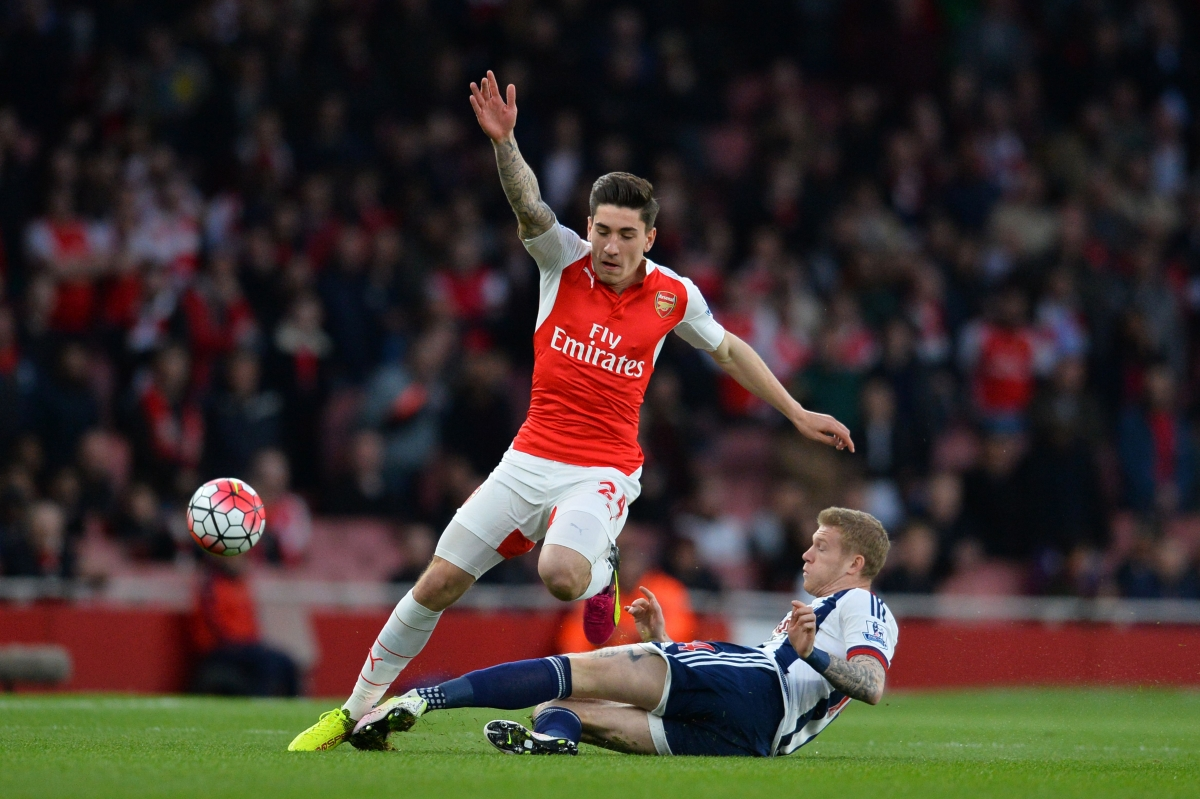 Hector Bellerin is tackled
