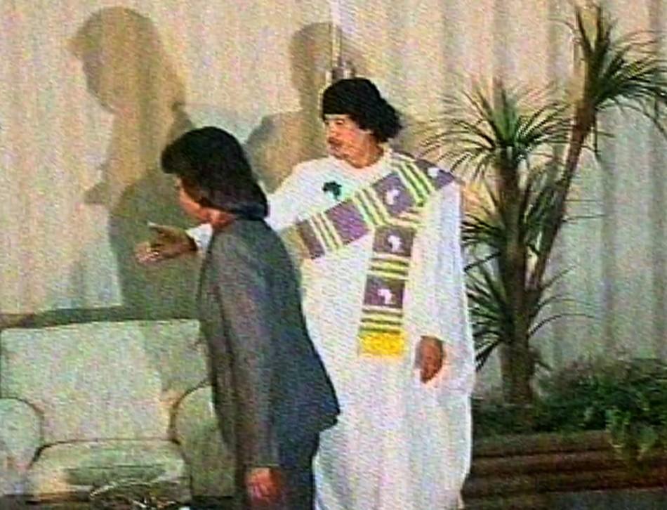 Video grab of Libyan leader Muammar Gaddafi welcoming U.S. Secretary of State Condoleezza Rice in a government compound in central Tripoli