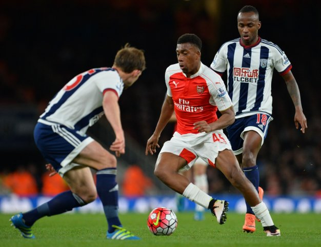 Alex Iwobi dribbles with the ball