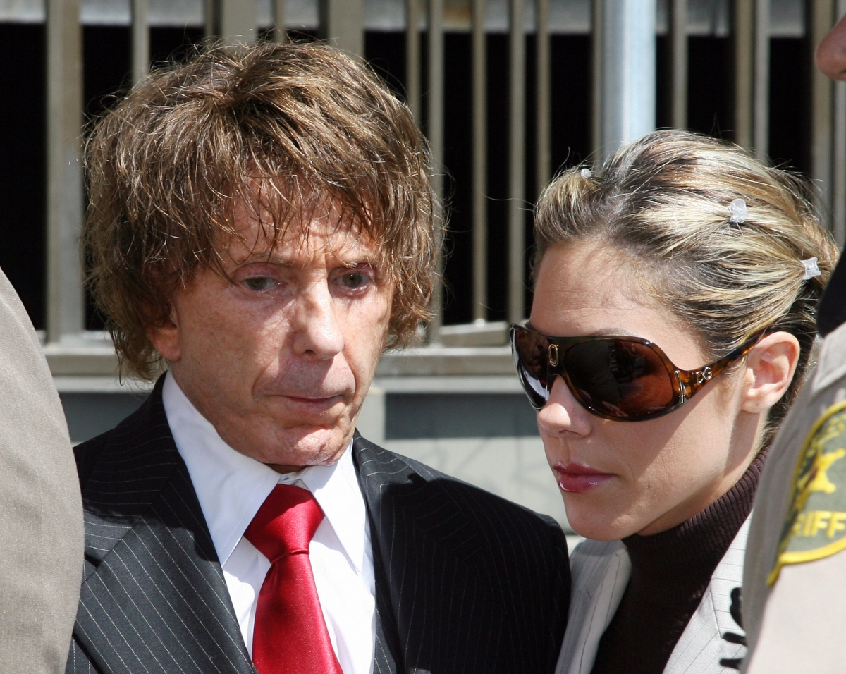 Music producer Phil Spector arrives with wifevRochelle