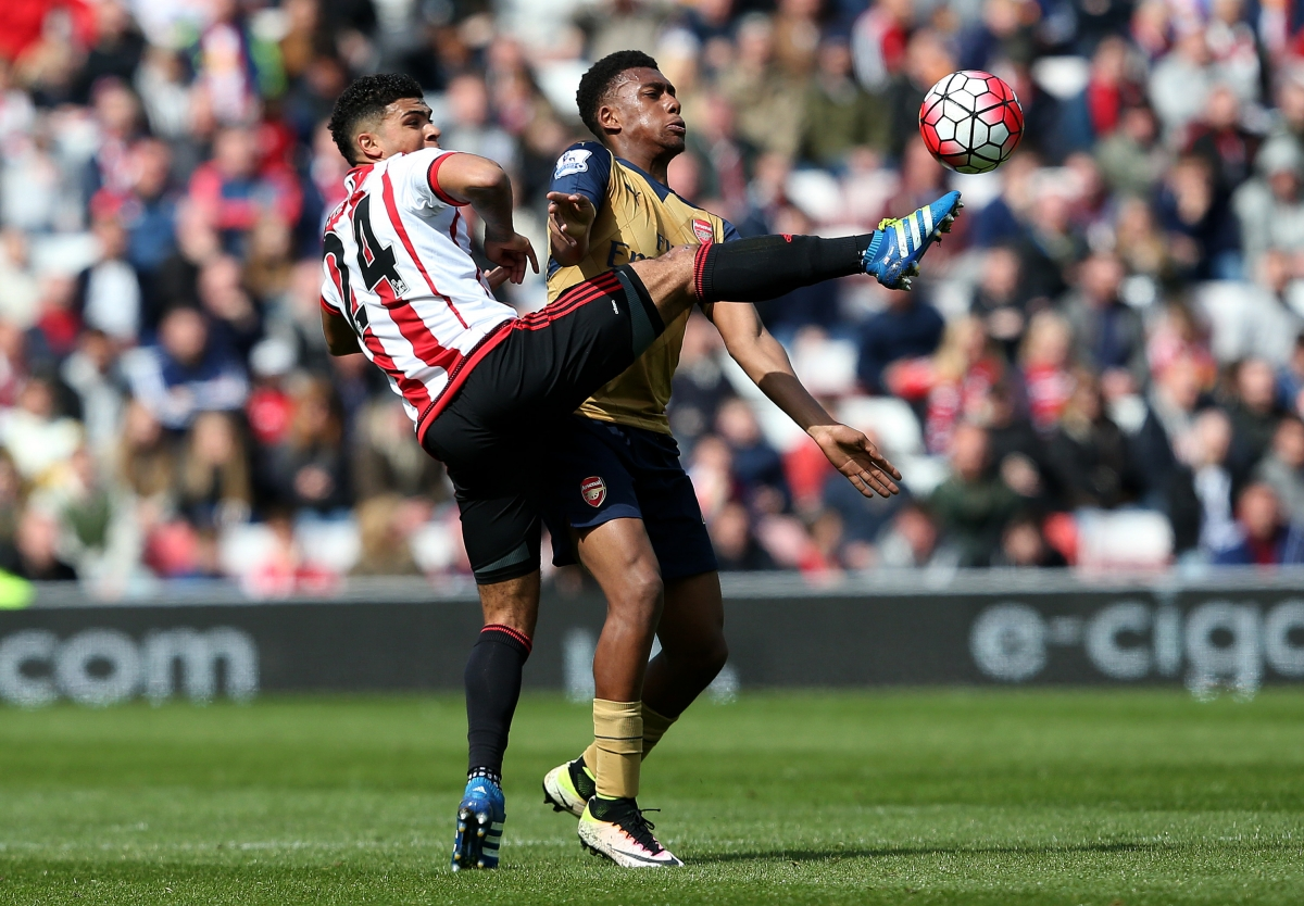 Alex Iwobi battles for the ball
