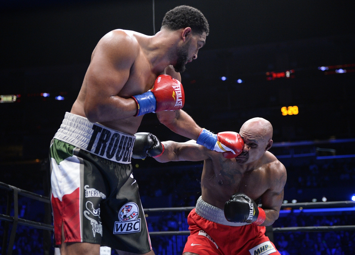 Dominic Breazeale (left) fighting against Amir Mansour