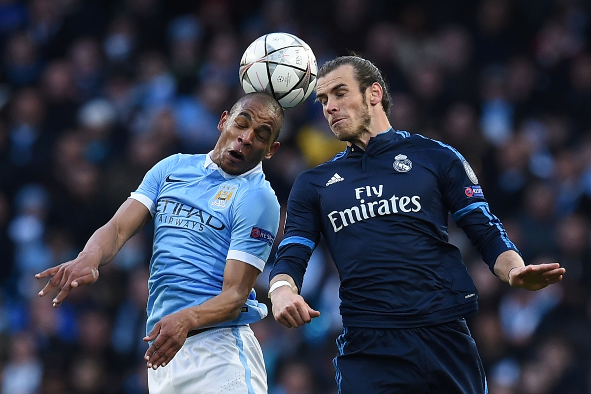 Bale (right) tries to win the ball