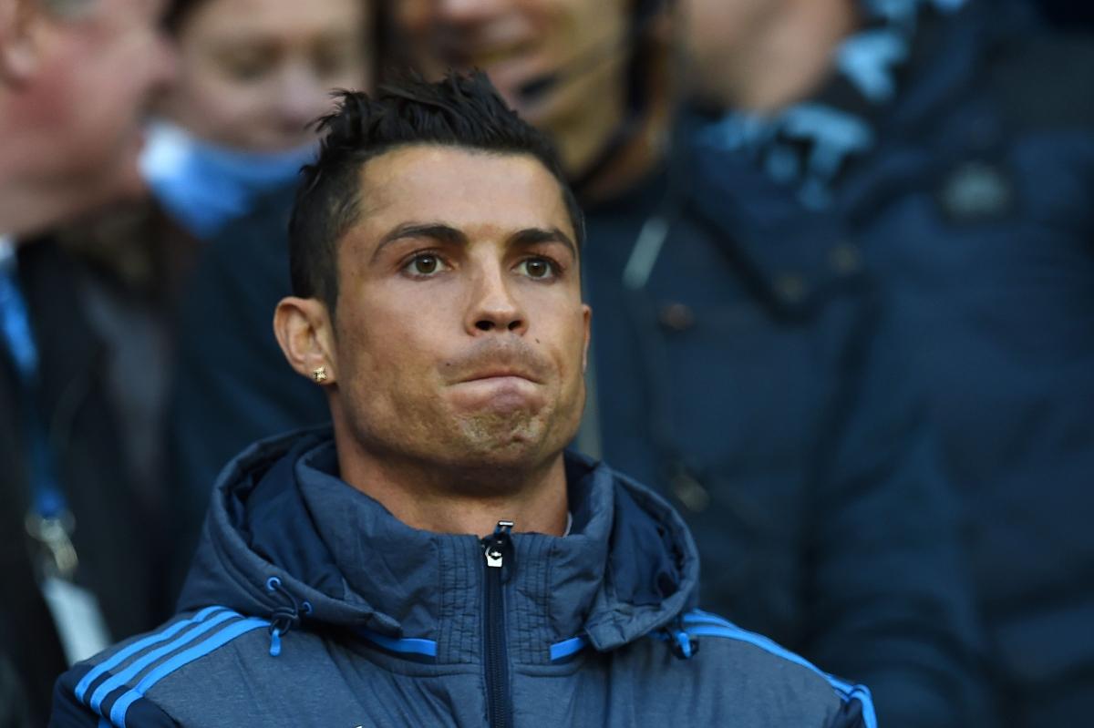 Cristiano Ronaldo watches the game