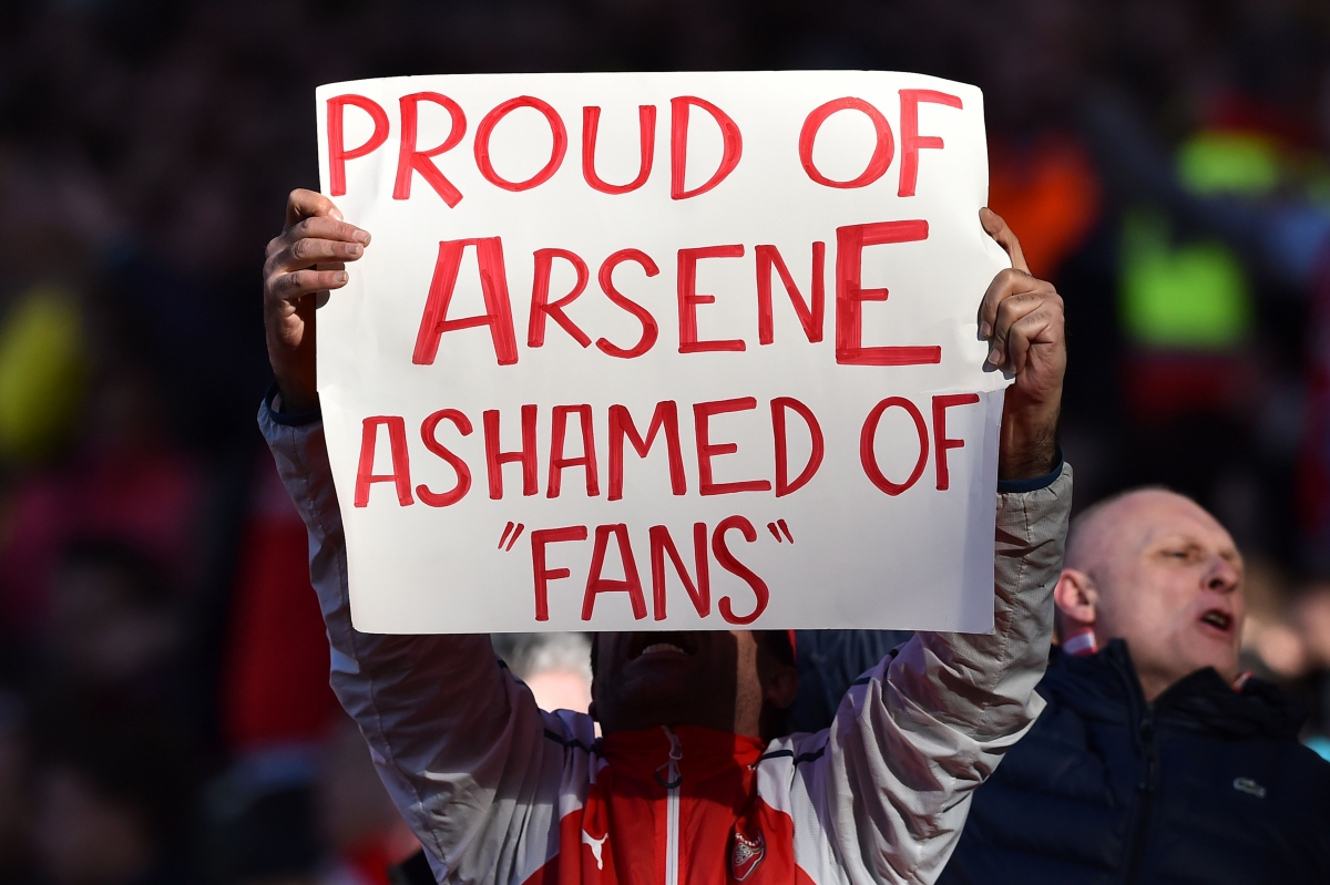 An Arsenal fan shows support for Wenger
