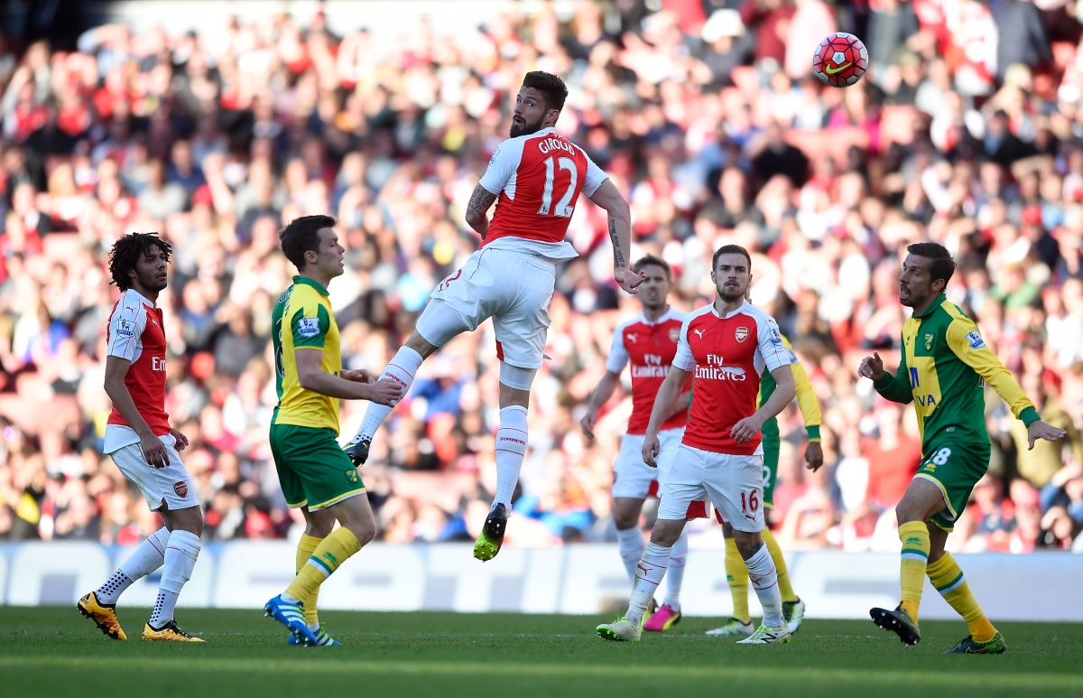 Giroud goes up for the ball