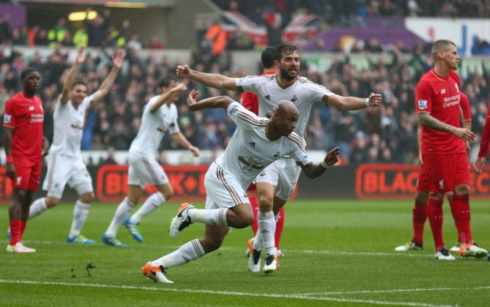 Swansea players celebrating their goal