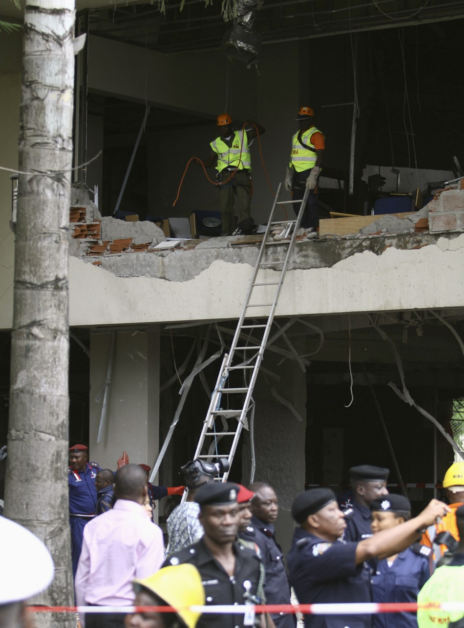 U.N. staff are seen after a bomb blast that ripped through the United Nations offices in the Nigerian capital of Abuja
