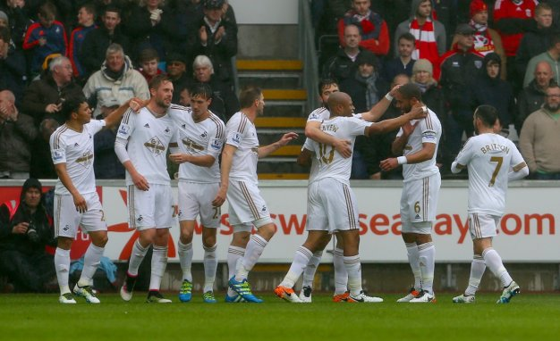 Swansea players celebrating a goal