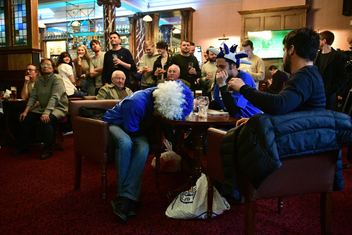 Leicester City fans watch anxiously