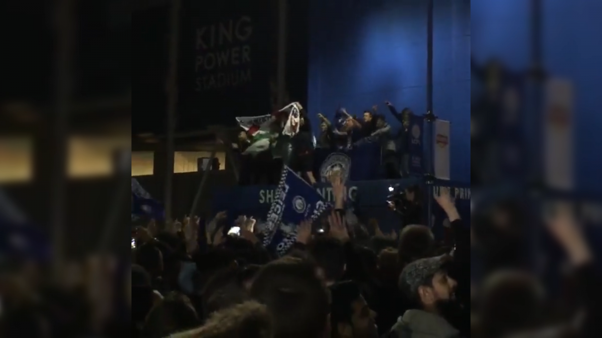 Leicester fans celebrate in the streets after Premier League victory