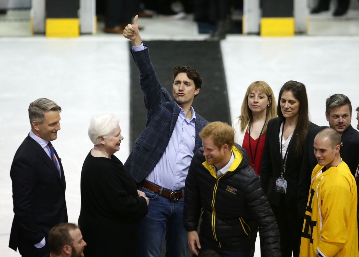 Justin Trudeau thumbs up with Prince Harry
