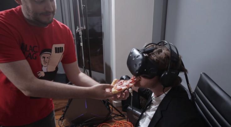 Derek Westerman being fed pizza