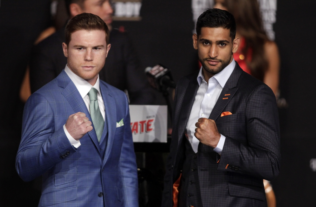 Canelo (left) and Amir Khan