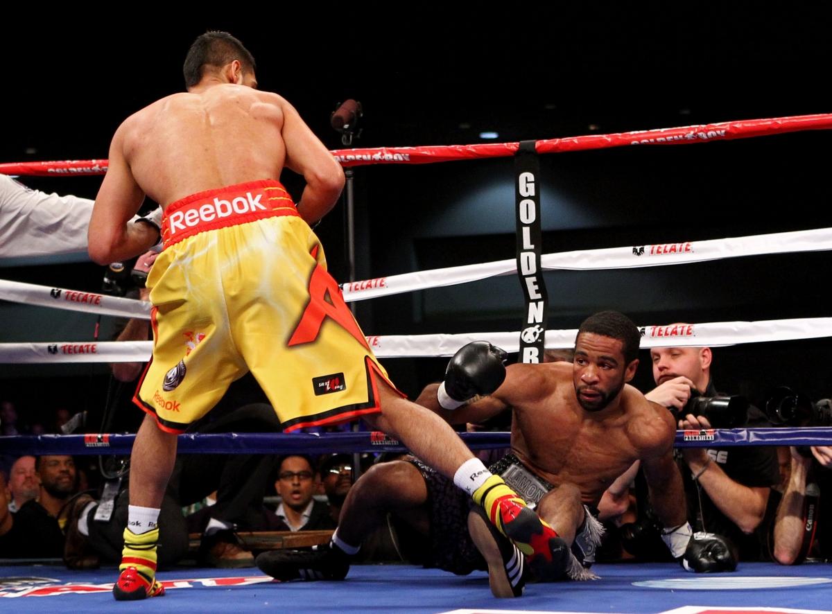 Khan knocks down Peterson