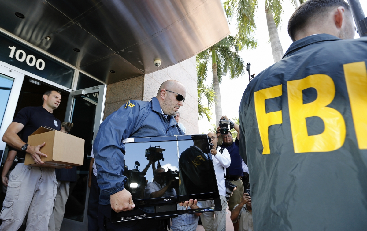 FBI agents conducting a raid