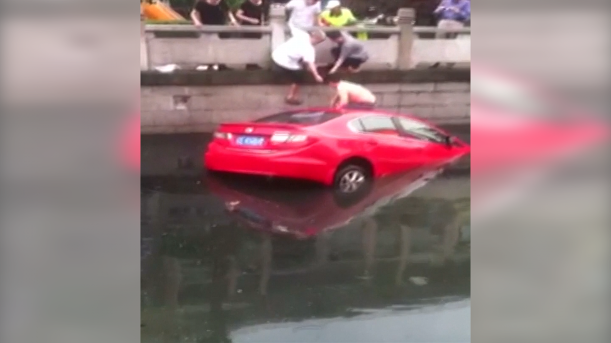 A woman was rescued from her car in east China's Jiangsu Province after she crashed into a river.