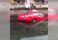 A woman was rescued from her car in east China\'s Jiangsu Province after she crashed into a river.