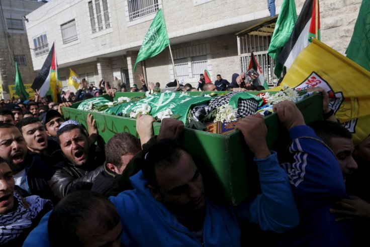 Palestinian men carry the body of Mohammed Ali
