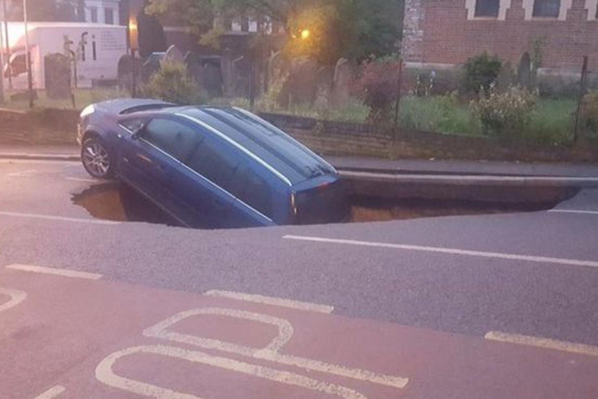 car falls down hole in Greenwich