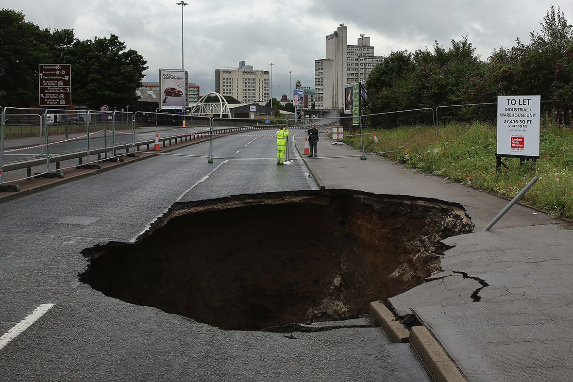dramatic photos of sinkholes and craters that have swallowed