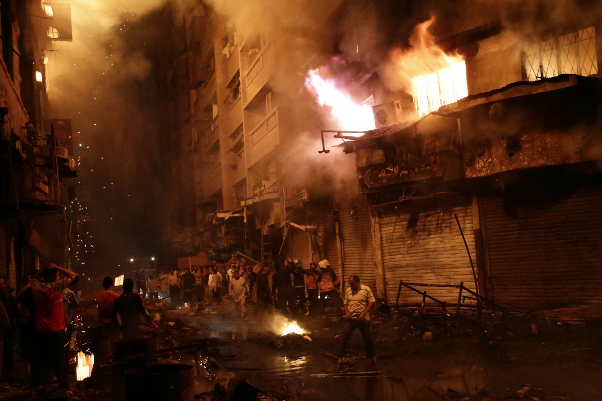 Egyptian firefighters extinguish fire at the popular market area of al-Atabaa in downtown Cairo