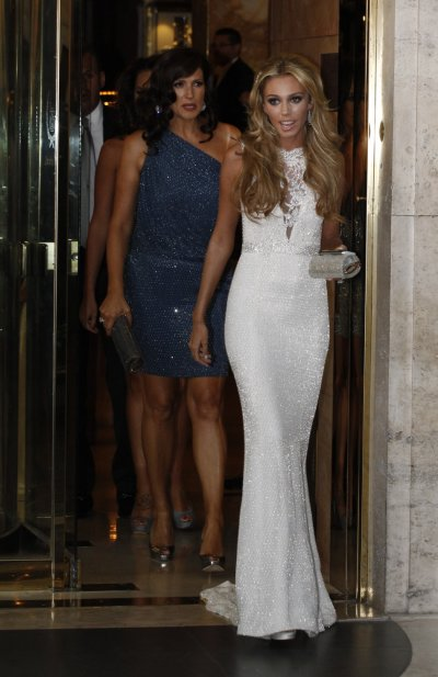 Petra Ecclestone R and Slavica Radic L, the daughter and former wife of Formula One Supremo Bernie Ecclestone, leave a hotel in downtown Rome August 26, 2011. Petra will marry her boyfriend of five years, James Stunt, at the Castello Odescalchi castle