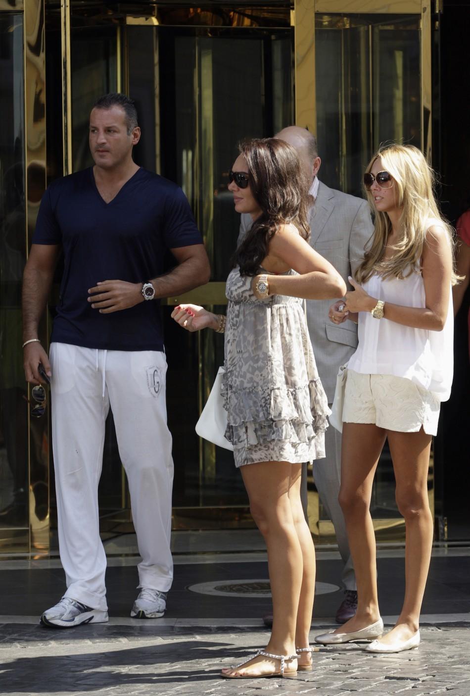 Tamara and Petra Ecclestone, daughters of Formula One supremo Bernie Ecclestone, leave a hotel in downtown Rome