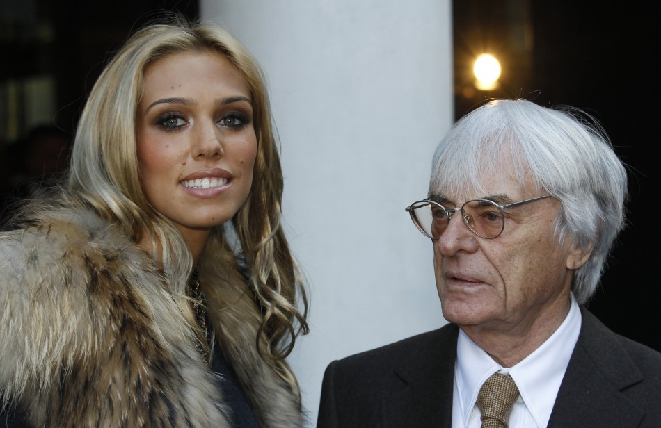 Formula One Chief, Bernie Ecclestone, and his daughter Petra, pose for photographers at the launch of One Hyde Park, in London