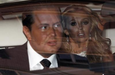 F1 Supremo Bernie Ecclestone,his daughter Petra and James Stunt leave a hotel in downtown Rome