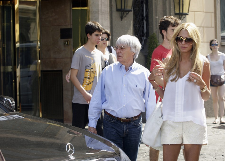 Formula One supremo Bernie Ecclestone and his daughter Petra leave a hotel in downtown Rome