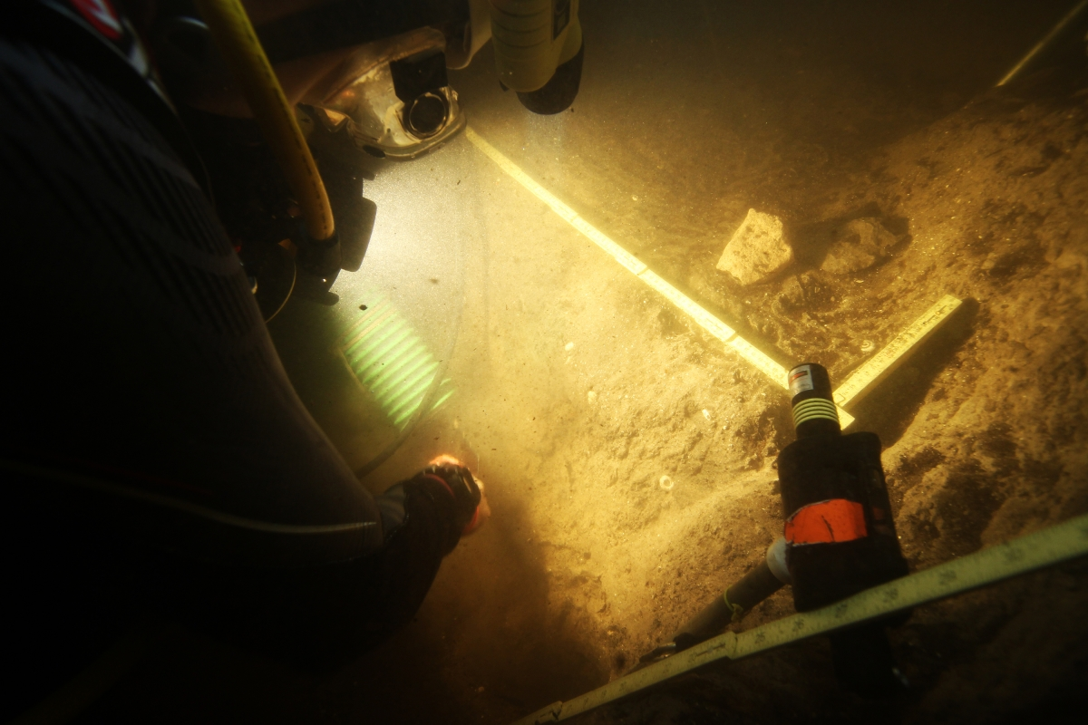 Divers at prehistoric site