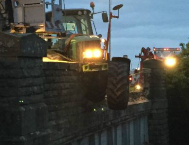A stolen tractor crashed on a railway bridge