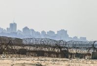 A picture taken from the beach in the southern Israeli kibbutz of Zikim shows the skyline of Gaza City