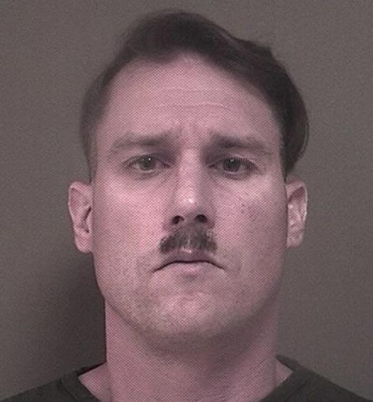 Bruce Post III, sports a Hitler moustache