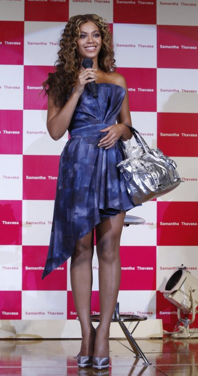 Beyonce looks pretty in purple during a promotional event for Japans fashion brand Samantha Thavasas new collection in collaboration with Disney in Chiba, east of Tokyo August 10, 2009