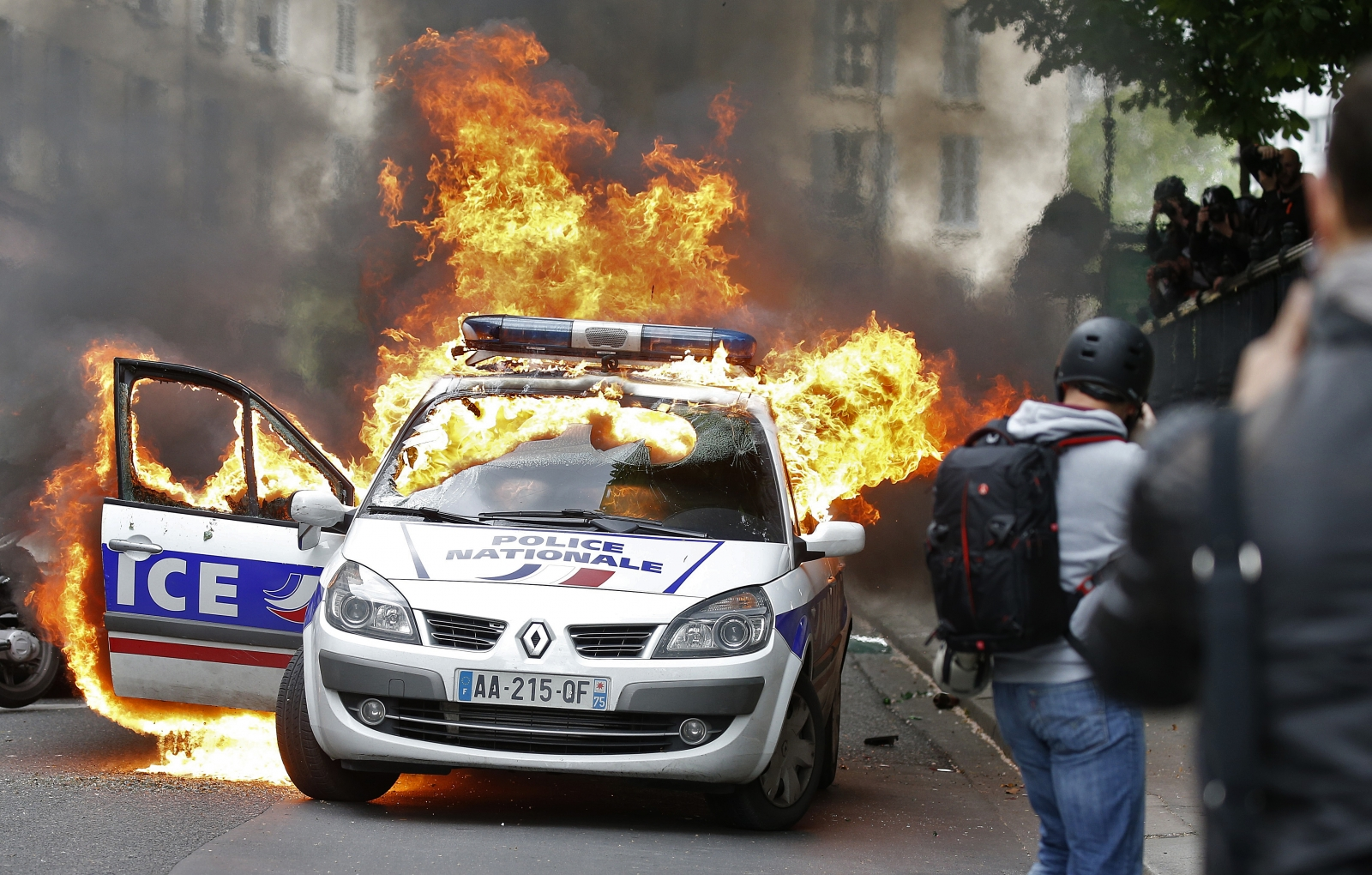 French protesters destroy police car