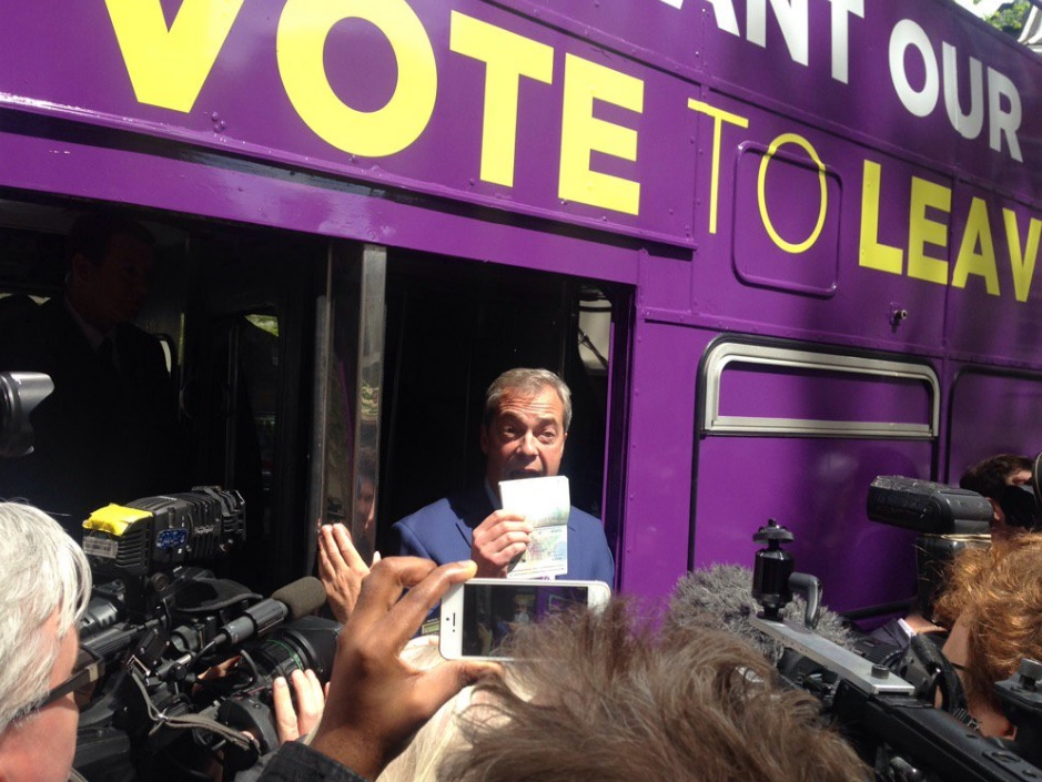 Nigel Farage shows his passport
