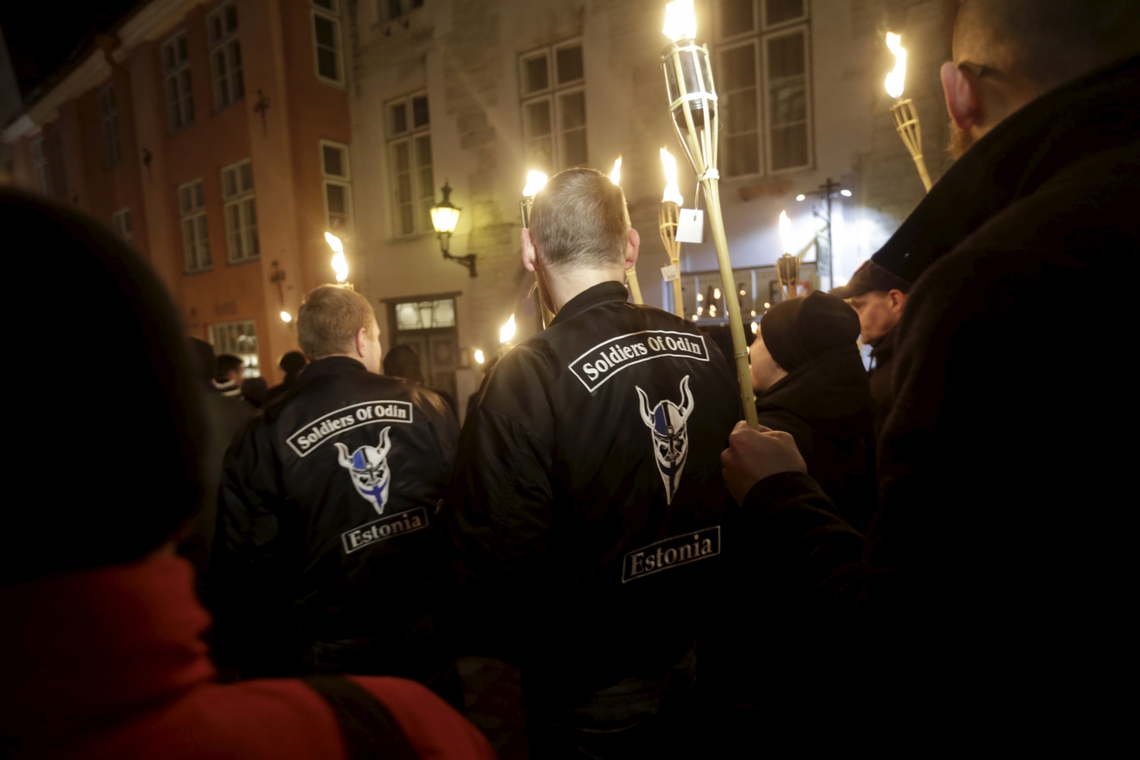 Members of the Soldiers of Odin march