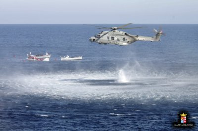 Migrants are rescued by the Italian Navy in the Mediterranean Sea