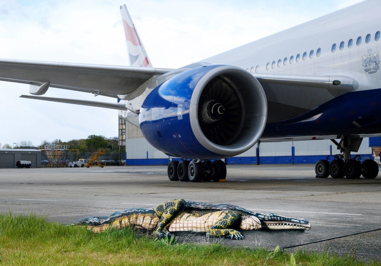 British Airways places human alligator on Gatwick airport runway to promote its offers to Florida
