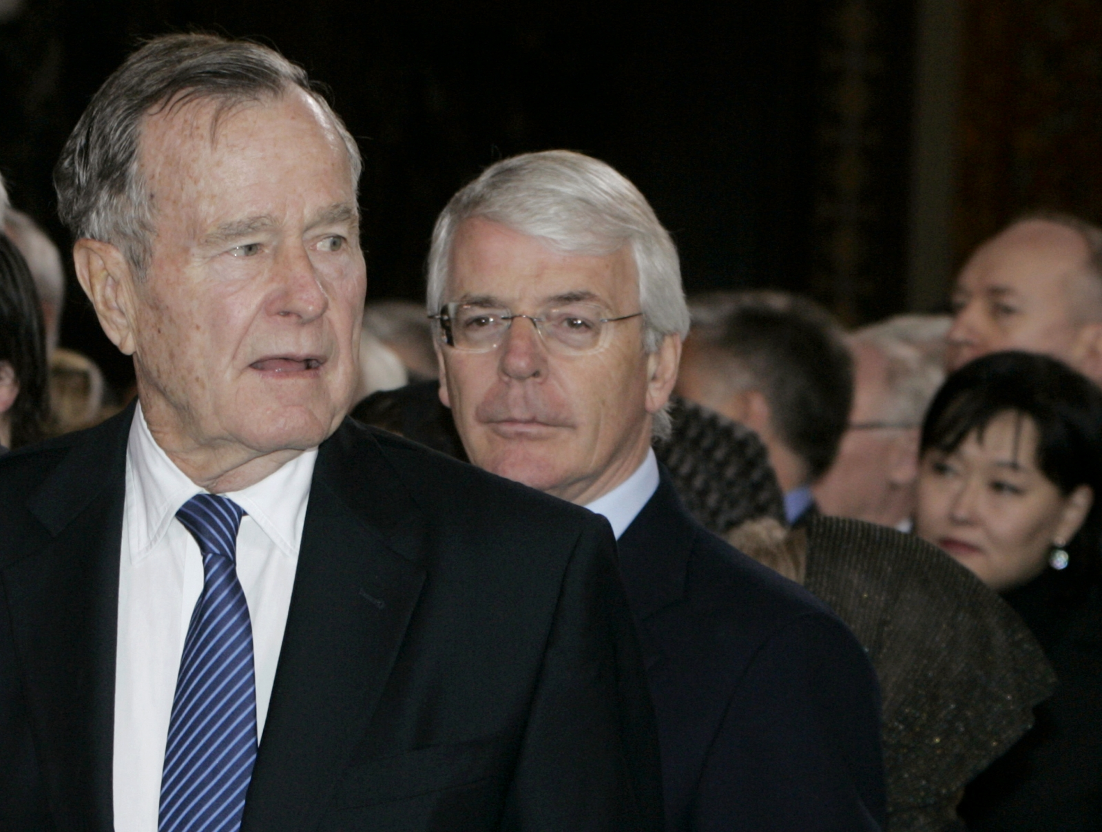 Former U.S. President George Bush (L) and former British Prime Minister Sir John Major